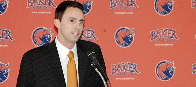 Former Kansas University director of basketball operations Brett Ballard was named the new head men's basketball coach at Baker University on Tuesday.