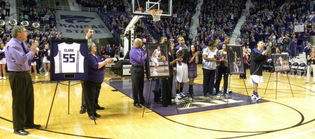 Rhett Clark, third from left, stands with his father, Phil, and mother, Betty, during the Senior Day festivities March 6 before the Iowa State-Kansas State game at Bramlage Coliseum. Clark first served as a basketball manager at Tonganoxie Junior High and Tonganoxie High School before joining the KSU team. This week, he'll join the team in Salt Lake City for the NCAA Tournament.