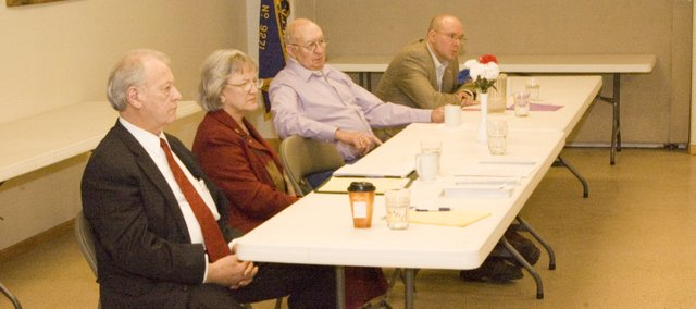 State reps. Owen Donohoe, R-Shawnee and Connie O'Brien, R-Tonganoxie, as well as moderator Harold Denholm and Rep. Lee Tafanelli, R-Ozawkie, listen to remarks from an audience member at Saturday's legislative update, sponsored by First State Bank and Trust and Tonganoxie VFW Post 9271. The event took place at the Tonganoxie VFW Post Home.