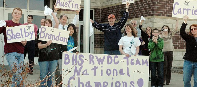 A group of Baldwin High School students and parents greeted the BHS Real World Design Challenge team Monday afternoon when it returned home from Washington D.C. The BHS team won the national competition Saturday.