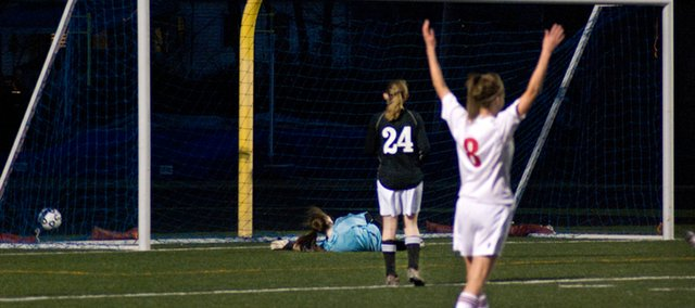 Megan Robinson starts to get up after Miege scored its sixth goal of the evening. The Wildcats started their season with 7-0 loss to Bishop Miege.