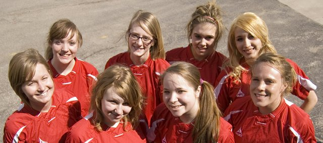 The seniors of Tonganoxie High's girls soccer team — (front row) Hilary Saathoff, Haley Wheeler, Sydney Bennett, Taylor Colgrove, (back row) Brittany Anderson, Danielle Lott, Lauren Williams and Kendra Walters — want to help the Chieftains win more matches this season than they have in their brief three-year history.