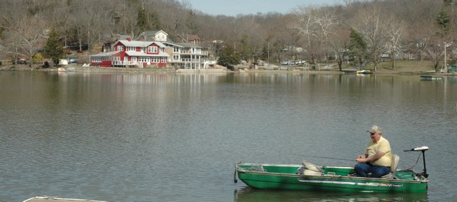 Lou Davis, Lake of the Forest resident, takes his boat out on the lake for an afternoon of fishing. This year, the Lake of the Forest community is celebrating its 100th anniversary of being a private housing district.