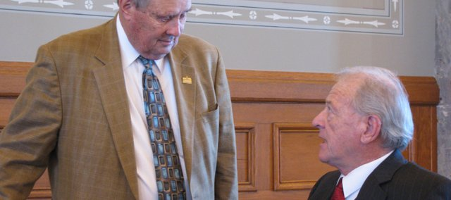 Rep. Owen Donohoe, R-Shawnee, right, speaks with Rep. Larry Powell, R-Garden City, at the Statehouse during the Legislative session. Donohoe recently missed half of the session due to a bypass surgery after discovering his heart was not receiving enough oxygen. Donohoe returned to work Feb. 22 committed to tackling the state budget, which he says is his biggest concern.