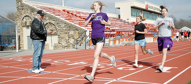 Members of the Baldwin High School girls' track and field team run sprints at Liston Stadium during spring break. Leading the way was freshman Monica Howard, with juniors Myranda Behrens and Ramie Burkhart trailing her. Coach Ted Zuzzio timed the Bulldogs.