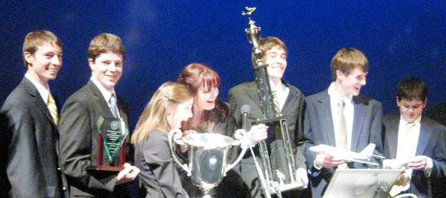 The Baldwin High School Real World Design Team reacts Saturday in Washington, D.C., after winning the national title competition. From left are Carson Barnes, Brandon Baltzell, holding the trophy from the FAA, Carrie Deitz, holding the governor's cup, which will be presented to the governor, Shelby Gregory, making sure Deitz doesn't drop it, Mason Johnson, holding the team trophy, Austin Kraus, holding the aircraft trophy, and Mac Halpin, holding an engraved Apple iTouch, which all team members received.