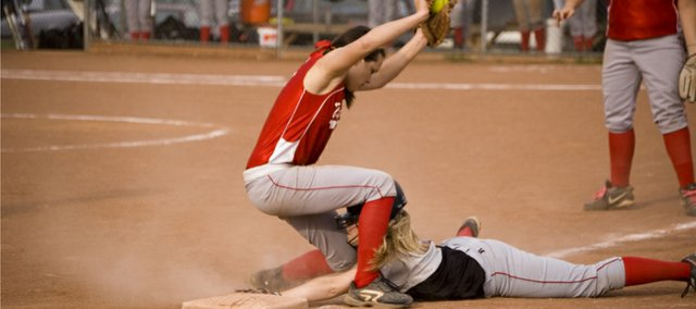 Tonganoxie High shortstop Kaitlyn Wolken tries to block a Jeff West runner from third base in the Chieftains' 6-2 loss to the Tigers on Thursday at Leavenworth County Fairgrounds. Wolken helped THS bounce back with a 15-14, extra-inning victory to split the doubleheader.