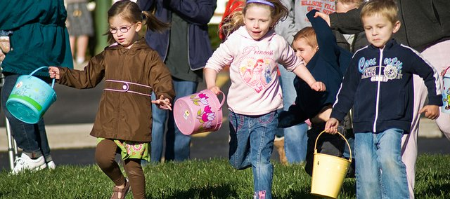 Mia Reith, 4, left, Aleaha Carpenter, 5, and Parker Phillips, 4, got off to a running start during the Hillside Village Easter egg hunt Saturday.
