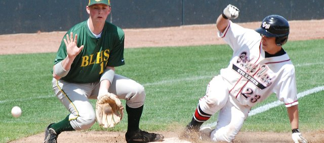 Bishop Ward's Alex Orel slides safely into third base as Basehor-Linwood's Dylan Belt awaits a throw.