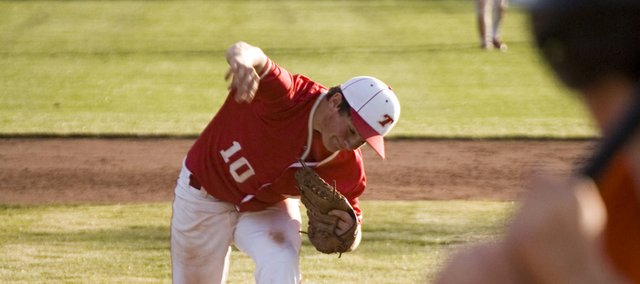 Dylan Puhr puts his whole body into a pitch against Bonner Springs. Puhr started for Tonganoxie in the team's season-opening, 10-7 loss and threw four innings.