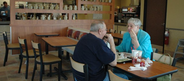 Roger and Ann Gaume enjoy an evening meal at the new Burger King in Bonner Springs. The Gaumes said this was their second time visiting the fast food restaurant since it opened Saturday.