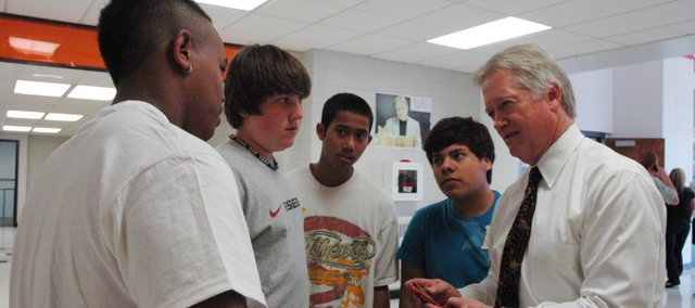 Bonner Springs High School principal Jerry Abbott speaks with BSHS students (from left to right) Major Brooks, senior, Austin Clouse, sophomore, Rotha Parks, sophomore, and Santiago Garcia, junior. Abbott recently announced he would retire at the end of the year.
