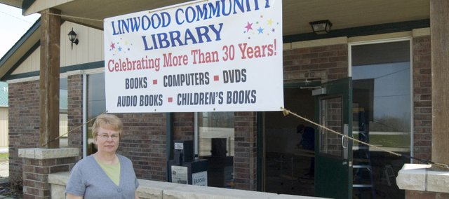 Linwood Community Library director Sue Peavy stands in front of the future home of the community library. The library board recently purchased the building, which is the former New Linwood Cafe on Kansas Highway 32. Peavy said the new library is expected to open in the fall.
