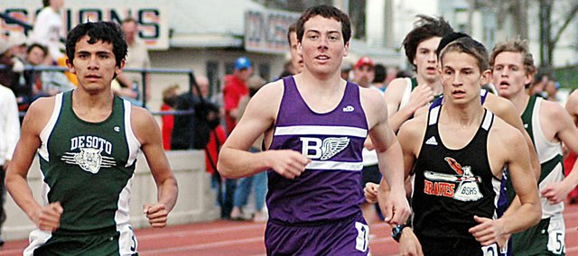 Baldwin High School junior Tony Weiss, center, paces the boys' 1,600-meter run along with De Soto's Angel Vasques early in the race Thursday. Weiss won the Baldwin Invitational race in a time of 4:44.25. Weiss also placed second in the 3,200-meter run.
