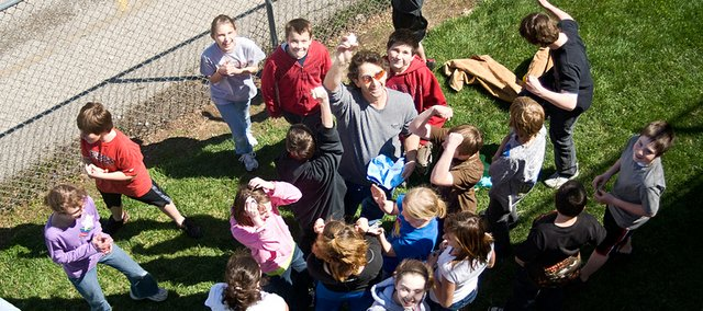 Jim Brabec's class celebrates after Kaylan Carney egg makes a safe landing from a 20-foot drop.