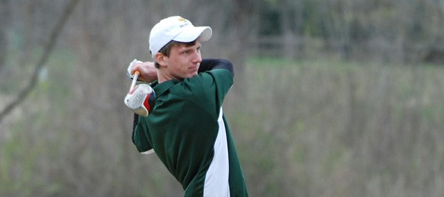 Basehor-Linwood senior Bobby Courtney watches his shot sail down the fairway during the Mill Valley Invitational.