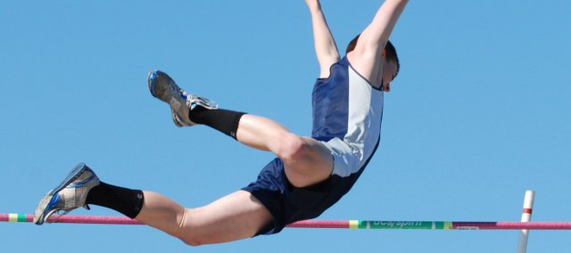 Mill Valley's Parker Brush soars over the bar at 13 feet, 6 inches, during the Jaguar Invitational. He later cleared 14 feet.