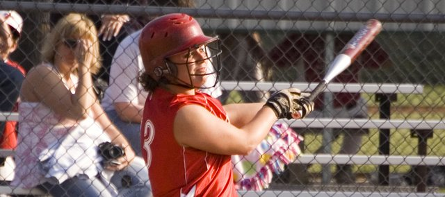 Lindsey Fatherley watches the flight of the softball just after knocking a pitch to the right-field gap that ended up being an inside-the-park home run as Tonganoxie High swept Piper, winning 5-2 and 6-2, on Thursday at Leavenworth County Fairgrounds.