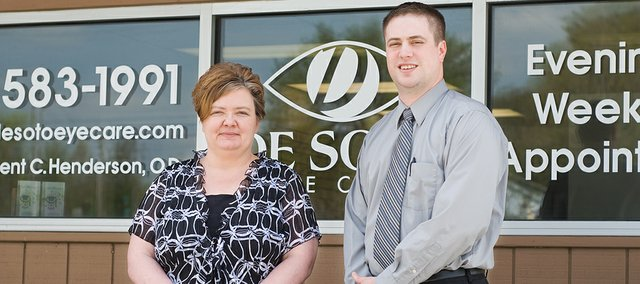 Trent Henderson, optometrist,  and Mary Espiricueta, insurance coordinator, stand in front of the new De Soto Eye Care sign. The new practice is still in the same building at 33321 Lexington Ave.