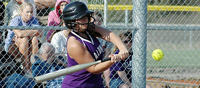 Baldwin High School junior Kyla Good swings for a pitch Friday afternoon at the Bulldogs' home game against Ottawa. The Bulldogs lost the game, but swept Spring Hill on Tuesday.
