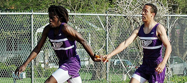 Baldwin High School sophomores Dayshawn Berndt, left, and Asher Hannon exchange the baton during the 800-meter relay Tuesday at the Baker Relays. Berndt and Hannon helped the Bulldogs win the final race of the meet, the 1,600-meter relay.