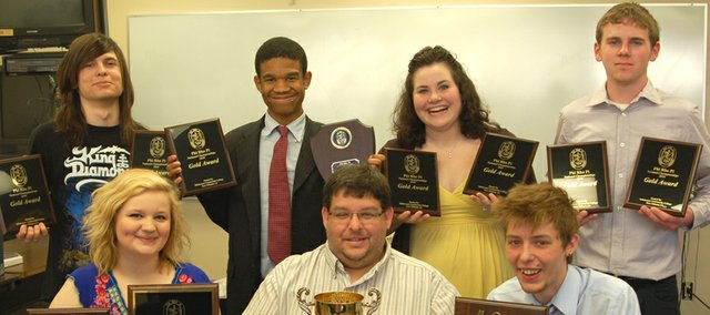 KCKCC's debate team brought home almost all the loot in winning a seventh straight National Phi Rho Pi Tournament. Flanking Coach Darren Elliott in front are Kristyn Russell (left) and Corey Lande while standing (from left) are Dennis Sudac, Aaron Thomas, Katelyn Lawson and Blake Burge.