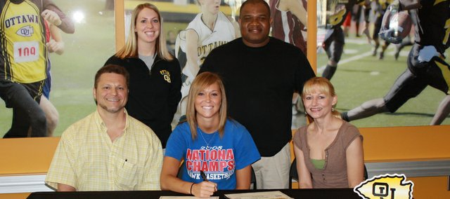 Tonganoxie High graduate Shannon Carlin, center, recently signed to play for the women's basketball team at Ottawa University. Carlin was joined at the signing by her parents, Jeff and Margaret, as well as OU assistant coach Brittany Broyles and OU head coach Bruce Tate.