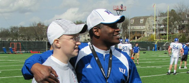 Tonganoxie High School senior Connor Olson chats with Kansas University football coach Turner Gill earlier this month. Olson and some of his friends had the opportunity to attend a KU practice. Olson also spoke to the team. After a brave battle with cancer that lasted more than a year, Olson died Wednesday, April 21.