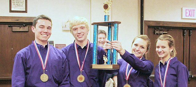 Baldwin High School students, from left, Colin Thomas, Britton Schroeder, Kara Hoegerl and Ellie Parr show off the first-place trophy that they won recently in the Kansas ProStart Student Invitational state competition in Wichita. The team was in the management competition and will now head for nationals.