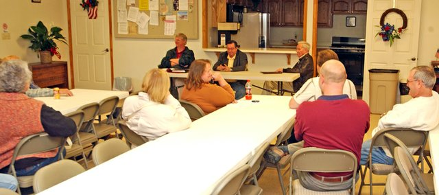 Leavenworth County Commissioners (from left) J.C. Tellefson, John Flower and Clyde Graeber answered questions and listened to comments from about 10 area residents Thursday evening at the Tonganoxie VFW Post on such topics as animal control and the county budget. 