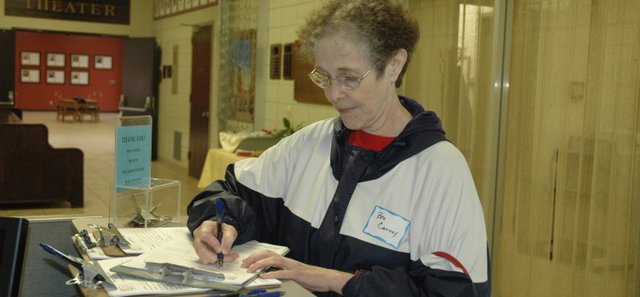 Beatrice Carney fills out a volunteer application form at the National Agricultural Center and Hall of Fame volunteer recruitment event Sunday, April 25.