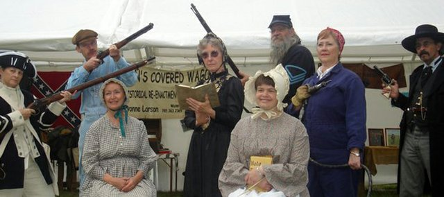 Historic performers strike a pose during the 2007 Kansas Sampler Festival in Garden City. Keyta Kelly, director of the 2010-2011 Kansas Sampler Festival, offers what people can expect from this year's festival this weekend in Leavenworth.