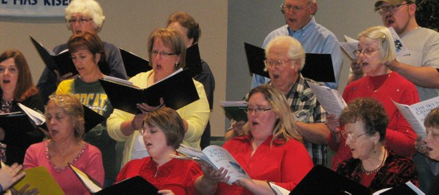 Members of the Kaw Valley Community Chorus rehearse Tuesday for their spring concerts.