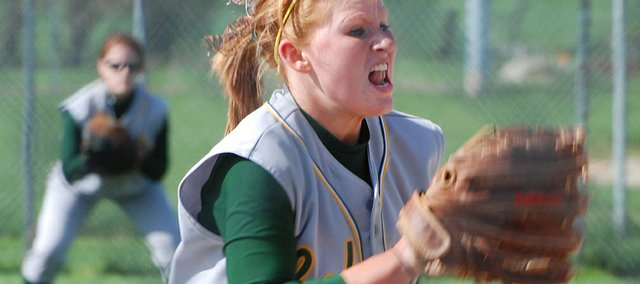 Brooke Redmond, a Basehor-Linwood sophomore, unleashes a pitch during game one of the Bobcats' doubleheader sweep of rival Lansing on Tuesday at Field of Dreams.