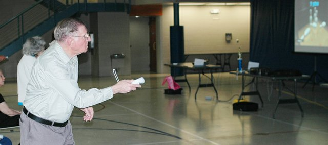 Warren Beach of Shawnee takes his turn Thursday at the Wii Bowling Tournament at the Shawnee Civic Centre. The tournament was the final event in a Wii bowling program for seniors.
