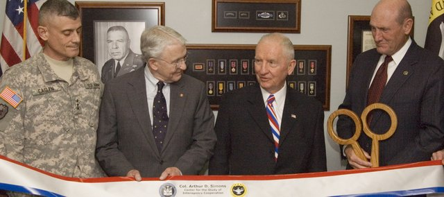 H. Ross Perot, second from right, was on hand for the opening of the Col. Arthur D. Simons Center on Wednesday, April 21, at Fort Leavenworth. Perot gave $6.1 million to the fort, including a portion that funded the Simons Center. The Texas billionaire and former presidential candidate also spoke as part of the Colin Powell Lecture Series. Also pictured are, from left, Robert L. Caslen Jr., commander of the Combined Arms Center and Fort Leavenworth, Bob Arter and Hyrum Smith, Command and General Staff College Foundation president.