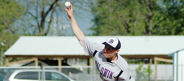 Baldwin High School junior Nate Growcock pitches during the opening game Tuesday at Paola. Growcock gave up one run during four innings on the mound. BHS won the game 11-3 before winning the second contest 7-5.