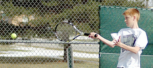 Baldwin High School sophomore Tucker Brown returns a volley during practice earlier this spring. Brown partnered up with junior Tim Larson and placed second at the No. 2 doubles team at the Frontier League tournament.