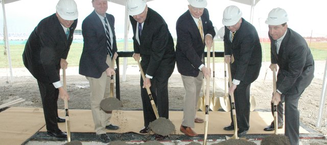 Officials involved with Wyandotte County's new Hollywood Casino break ground Friday morning at the casino future site next to the Kansas Speedway in Kansas City, Kan. Pictured are: (from left)  Jeff Boerger, president of Kansas Speedway Development Corporation;  Joe Reardon, mayor of the Unified Government of Wyandotte County; Ed Van Petten, Kansas Lottery executive director; William Falstad, commissioner of the Kansas Racing and Gaming Commission; Troy Findley, lieutenant governor of Kansas; and Tim Wilmott, president and chief operating officer of Penn National Gaming.
