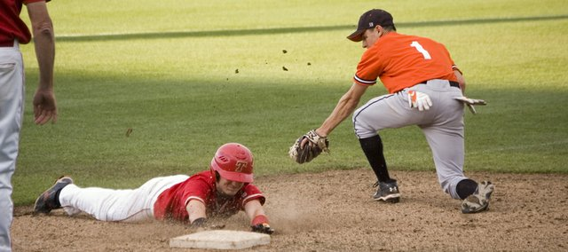 Tonganoxie High junior Jeremy Wagner slides in safely under the tag of Bonner Springs third baseman Luke Porras in the third inning of the Chieftains' 7-4 victory at CommunityAmerica Ballpark, in Kansas City, Kan., on Friday.