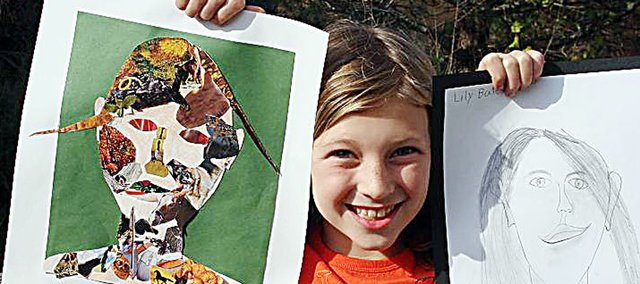 Lily Bates, a fourth grader at Marion Springs Elementary School, holds two self portraits that she created to be a part of the next exhibit by Baldwin School District students at the Lumberyard Arts Center. The elementary students will have their work on display beginning May 6.