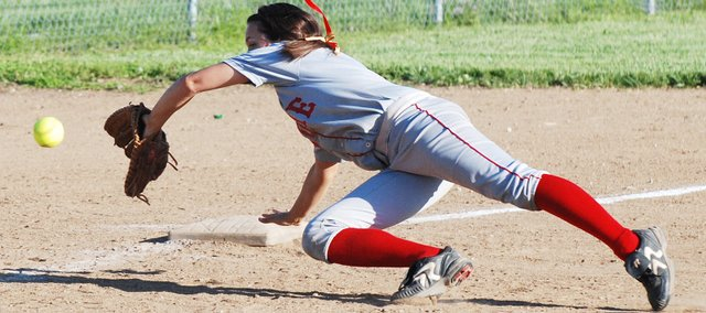 Tonganoxie third baseman Kaitlyn Wolken stretches to try to stop a sharp ground ball during the Chieftains' 10-inning victory against Bonner Springs.