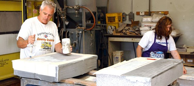 Bill and Jan Jones work on memorial stones in their shop south of Tonganoxie. The couple recently moved the Eagle Memorial store to the southeast corner of U.S. Highway 24/40 and Kansas Highway 16 in Tonganoxie.