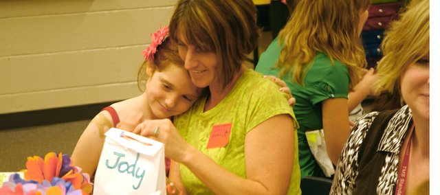 Jody Moritz shares a moment with her daughter Aspen at Thursday's Mother's Day Tea in Denna Sittner's second-grade classroom at Tonganoxie Elementary School.