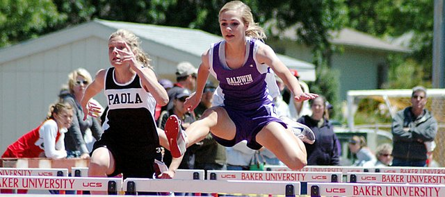 Baldwin Junior High School eighth grader Morgan Lober, right, won the 100-meter hurdles in a time of 17.43 seconds Saturday at the Frontier League track and field meet. There will be a story on the Bulldogs' success in Thursday's Signal.