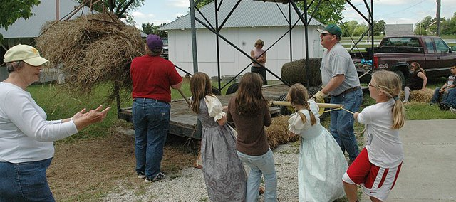 Vinland Elementary School students got a lesson in old-fashioned haying during Founder's Day events Tuesday at the Vinland Fairgrounds.
