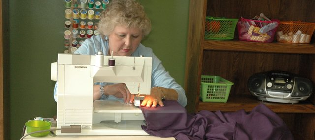 DiAnne Berning, who recently retired after two decades as bookkeeper at Bonner Springs High School, opened DiAnne's Alterations earlier this month in downtown Bonner Springs.
