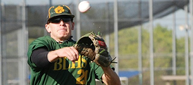 Ryan Lawless, Basehor-Linwood shortstop, flings a throw to first base for an out after charging a ground ball. BLHS split a doubleheader against Mill Valley.