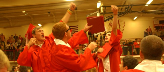 Tonganoxie High School Class of 2010 members climb on chairs to celebrate their graduation soon after the conclusion of the Saturday's ceremonies at the THS gymnasium.
