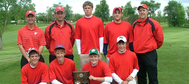 The Tonganoxie High golf team poses Monday at Hiawatha after finishing second at a Class 4A regional tournament and qualifying for state. Pictured are: (front row) Tanner Hale, Kody Campbell, Mitch DeHoff, Colby Yates, (back row) head coach Jared Jackson, assistant coach Doug Sandburg, Justin Jacobs, Eric Laboyteaux and assistant coach David Walker.